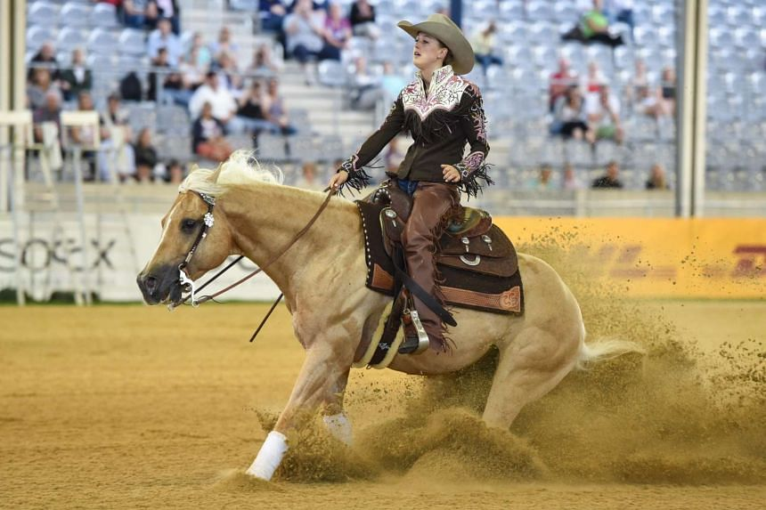 """Gina Schumacher on her horse Sharp Dressed Shiner executes a so-called """"sliding stop""""."""