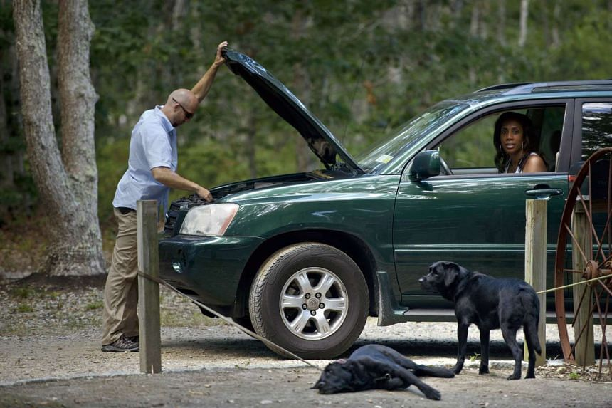 Police K-9s wait while a car is seached on its way to Farm Neck Golf Club.