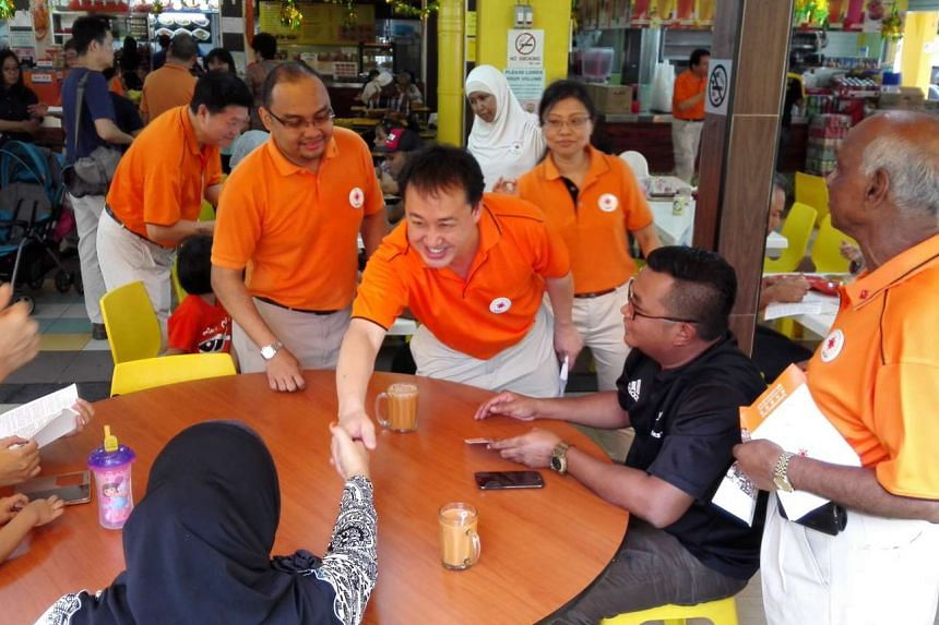 The National Solidarity Party members talking to residents during the walkabout in Tampines.