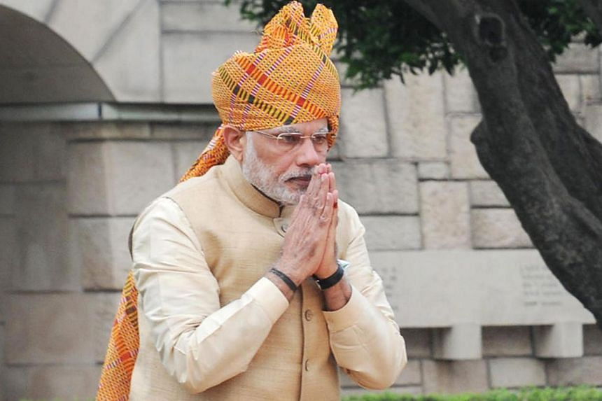Prime Minister Narendra Modi paying his respects at the Samadhi of Mahatma Gandhi in New Delhi, on India's Independence Day, Aug 15.