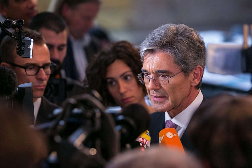 Joe Kaeser, chief executive officer of Siemens AG, speaks to journalists after the company announced their second-quarter results in Berlin, Germany, on May 7, 2014.