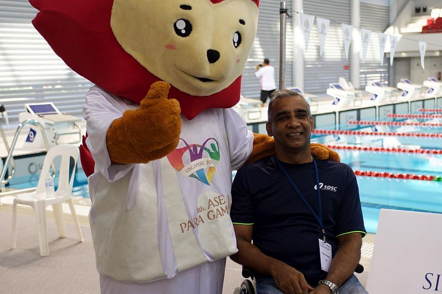 Mr Raja Singh, Singapore's chef-de-mission for the Asean Para Games 2015, with mascot Nila.