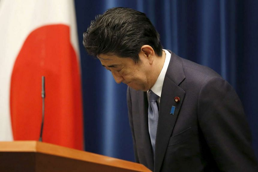 Japanese Prime Minister Shinzo Abe bowing as he left a news conference at his official residence in Tokyo yesterday after delivering a statement marking the 70th anniversary of the end of World War II.