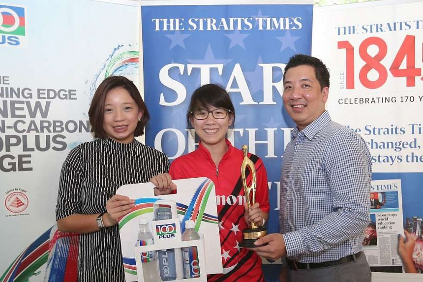 Joey Yeo, 17, receiving her prizes from F&N Foods marketing manager Celine Tan and ST sports editor Marc Lim.