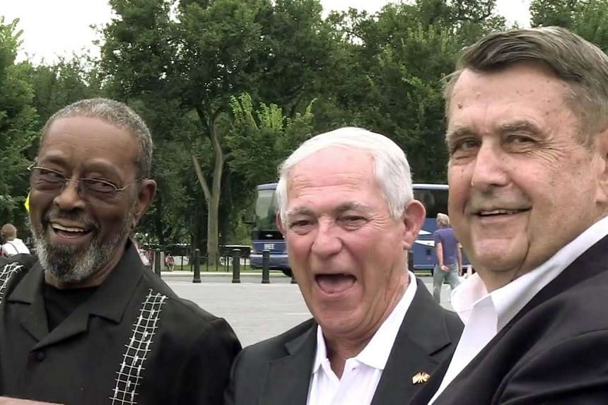 Former marines (from left) F. W. East, Larry Morris and Jim Tracy, who lowered the US flag at the embassy in Havana in 1961, returned to the island to raise the flag again.