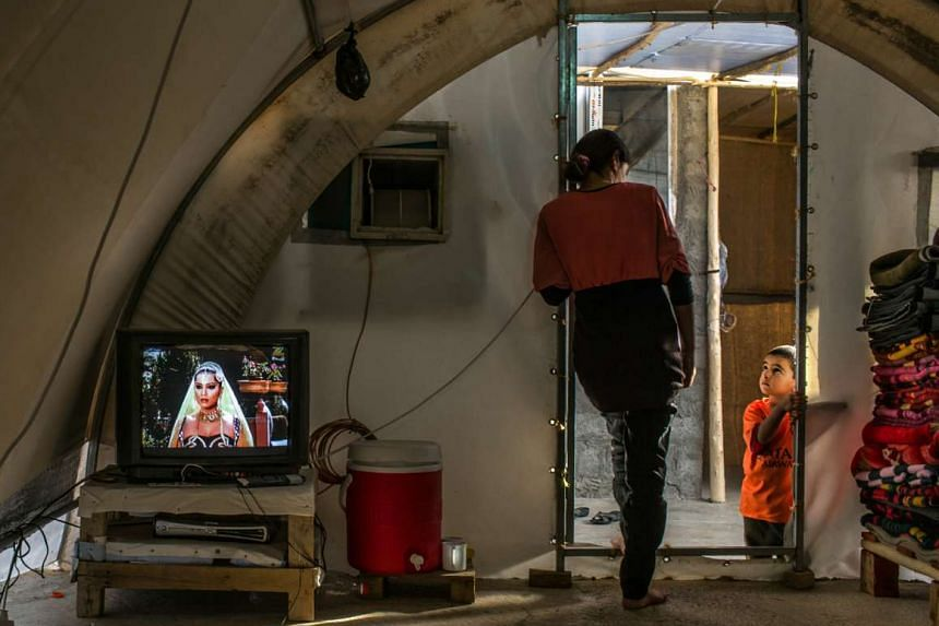 F, a 15-year-old girl who endured repeated rapes at the hands of her ISIS captors, with her four-year-old brother in a tent at a refugee camp in Iraq.