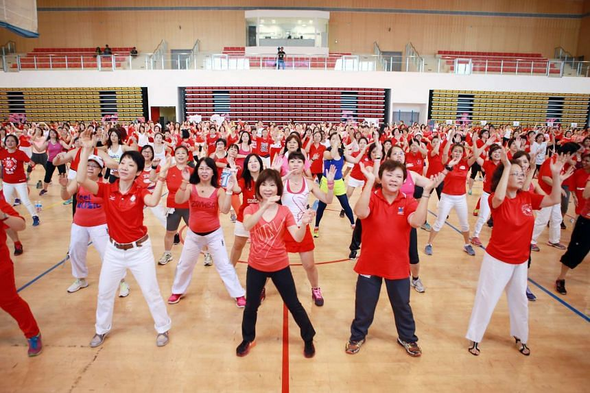 "(Front row, from left) Ms Grace Fu, Dr Amy Khor and Ms Ellen Lee dancing Zumba to a specially choreographed version of the National Day song ""Stand Up for Singapore""."