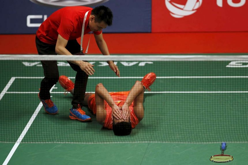 China's Chen Long reacts winning Malaysia's Lee Chong Wei after their men's finals badminton match at the BWF World Championships in Jakarta, Indonesia on Aug 16, 2015.