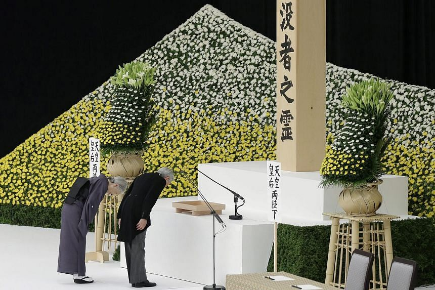Japanese Emperor Akihito and Empress Michiko bowing before an altar during a memorial service to mark the 70th anniversary of the end of World War II at Nippon Budokan Hall in Tokyo yesterday.