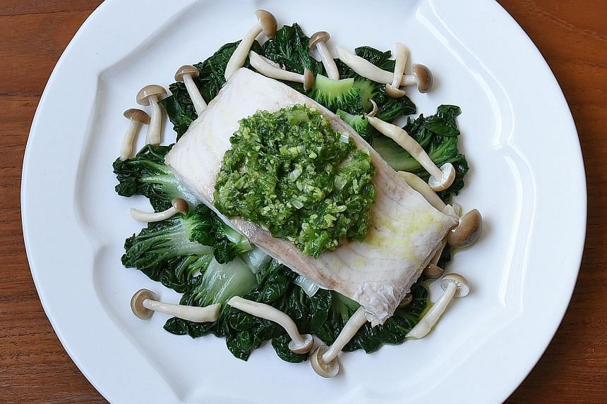 The scallion- ginger sauce spooned over steamed fish.