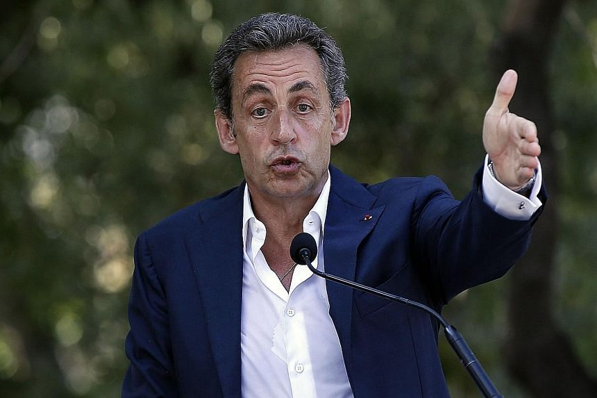 Mr Nicolas Sarkozy's (left) comeback campaign is underpinned by a shrewd political strategy. His first move was to engineer the merger of a number of centre-right political parties, with the aim of providing a single opposition platform against Mr Fr