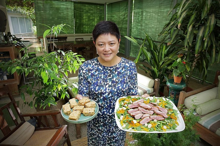 Ms Anita Fam with butterscotch bars and duck salad which she made herself.
