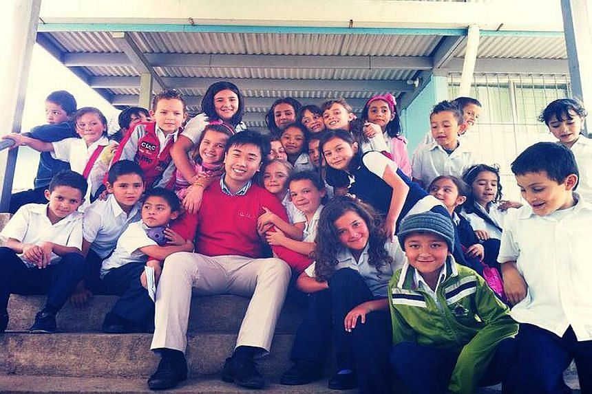 Mr Zhou with children in Poasito, Alajuela, in Costa Rica.