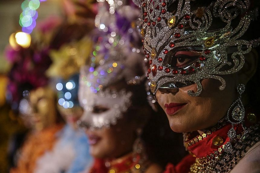 Participants don elaborate bejewelled masks during the Mask Street Parade at the Malaysia International Mask Festival in Kuala Lumpur yesterday. They hail from many countries, including Indonesia, the Philippines, Japan, South Korea, Brazil, Thailand