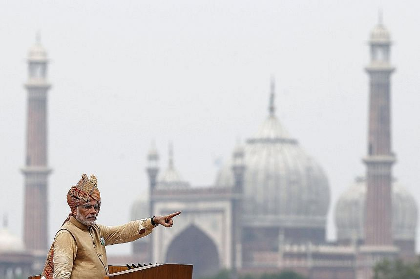 Indian Prime Minister Narendra Modi addressing the nation from the Red Fort in New Delhi (above) yesterday. He pledged to provide electricity to 18,500 villages in the next 1,000 days.