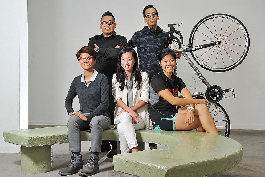 (From left, seated) Ms Nur Uzaimah Fadzali, Ms Patricia Yee and Ms Tan Peining, and (from left, standing) ex-Club Rainbow (Singapore) beneficiaries Muhammad Sharil Abdul Hamid, 25, and Muhammad Azrin Ali, 26, will cycle in the Ride for Rainbows event