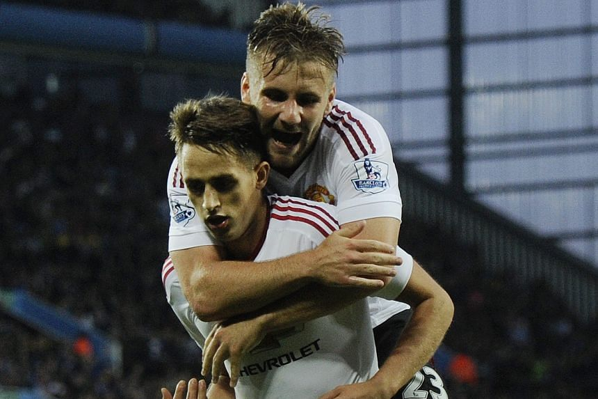Adnan Januzaj (front) celebrating with team-mate Luke Shaw after scoring against Villa during a rare start. The Belgian later denied talk that he wanted to leave and pledged to fight for a regular place.