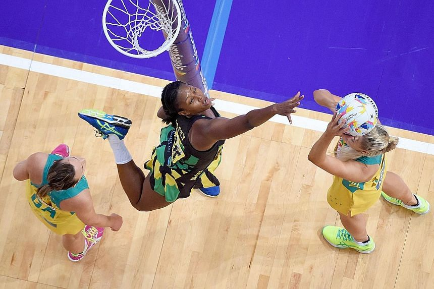 Caitlin Bassett (right) of Australia shooting against Jamaica's Stacian Facey in the hosts' 67-56 World Cup semi-final win. The pace and physicality of non-Asian teams are a major challenge for Singapore.