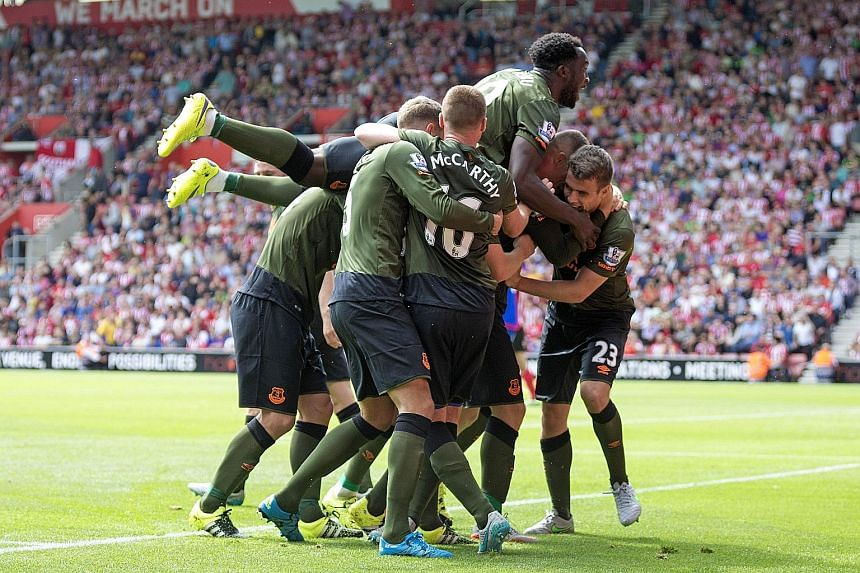 Romelu Lukaku (top) is on a high after Ross Barkley scores the third and final goal of the match for Everton against Southampton yesterday.
