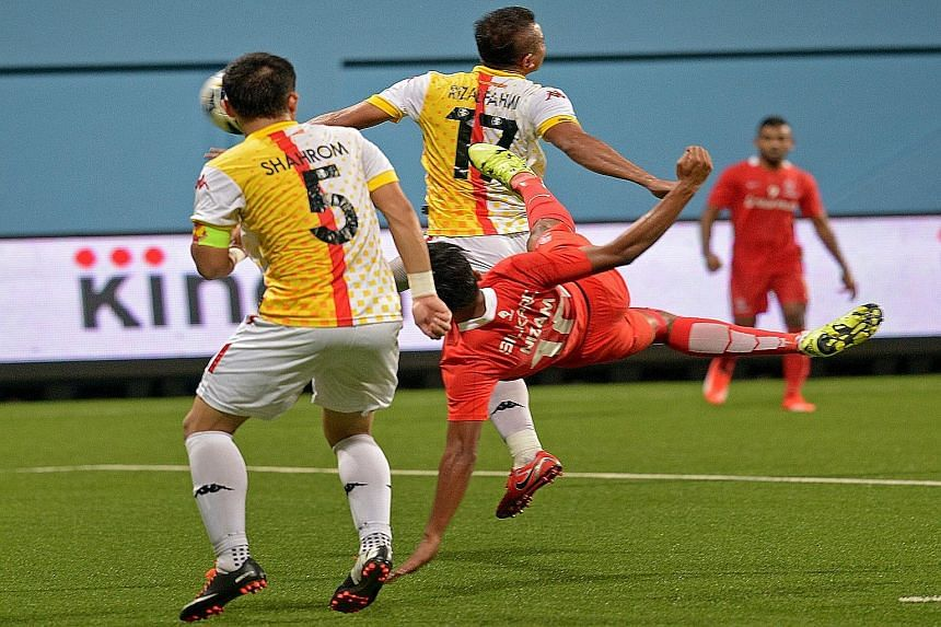 Khairul Nizam (in red) delivering his stunning late equaliser against old rivals Selangor at Jalan Besar Stadium last night, helping the LionsXII to remain in seventh spot.