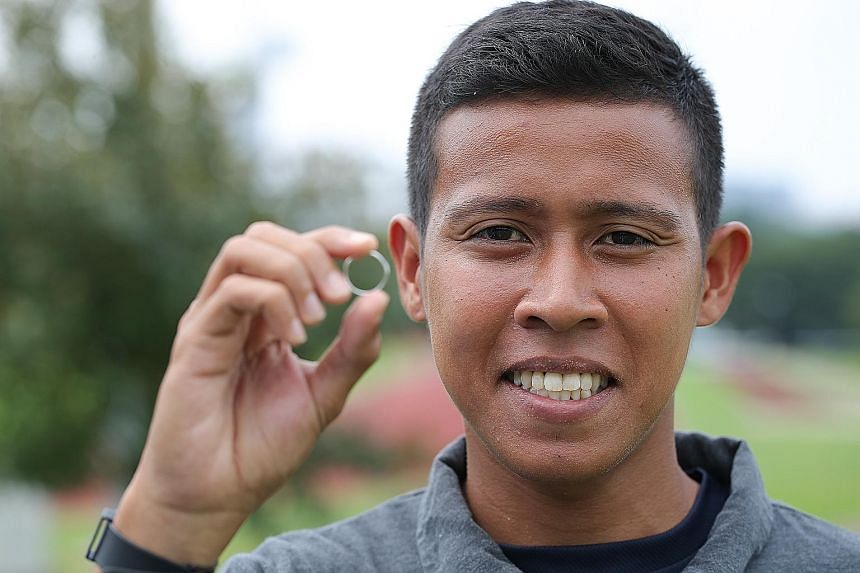 Full-time national serviceman Aliff Noor Hakim, 24, found the wedding ring engraved with the name Collin Toh at a bus stop in Eunos. He tracked down Mr Toh on Facebook and returned the ring last month.