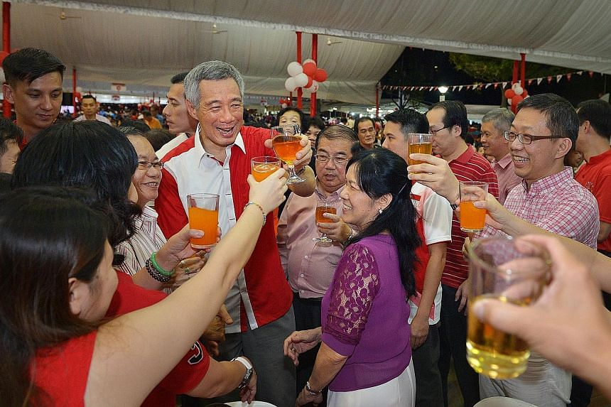 Prime Minister Lee Hsien Loong leading a toast at a National Day dinner in Teck Ghee last night. In his speech, Mr Lee said that as Singapore rose from Third World to First, so has Ang Mo Kio progressed. More improvement works are in the pipeline, he