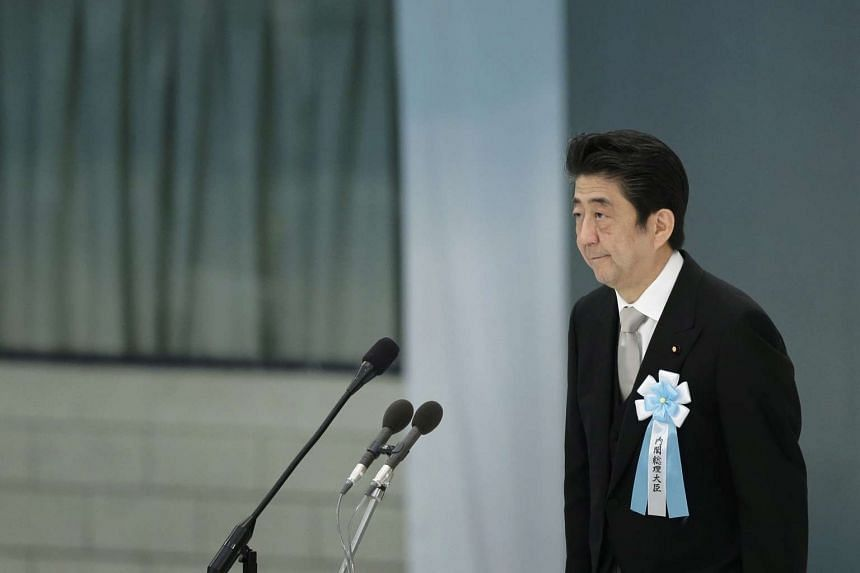 Japanese Prime Minister Shinzo Abe makes a speech during a memorial service at Nippon Budokan Hall in Tokyo, Japan on Aug 15, 2015.