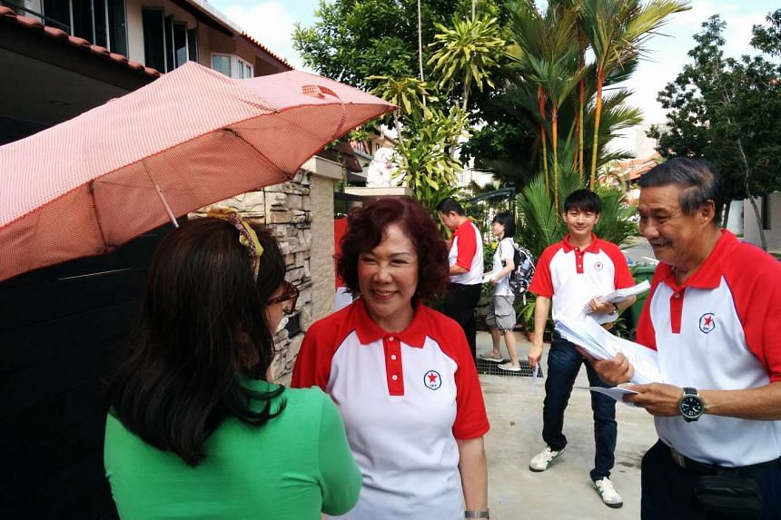 Singapore People's Party chairman Lina Chiam (centre) greeting Potong Pasir residents during a walkabout on Aug 16, 2015.