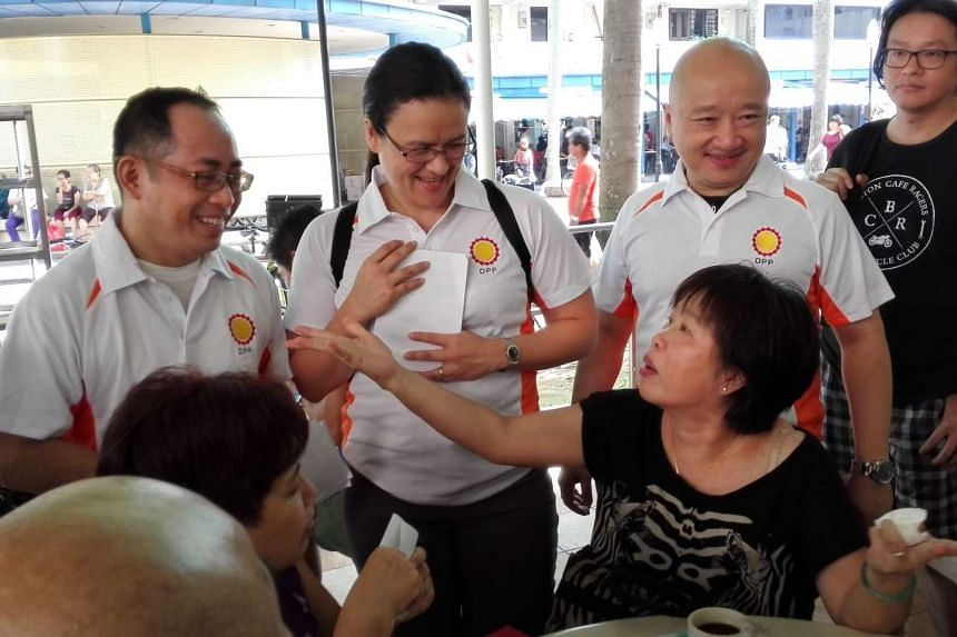 Democratic Progressive Party members (from left) Chia Ser Lin, Nadine Yap and Benjamin Pwee greeting residents at Lorong 4 Toa Payoh on Aug 16, 2015.