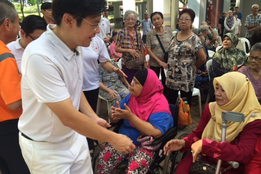 MCCY minister Lawrence Wong, one of the anchor MPs for the new Marsiling-Yew Tee ward, greeting residents on Sunday.