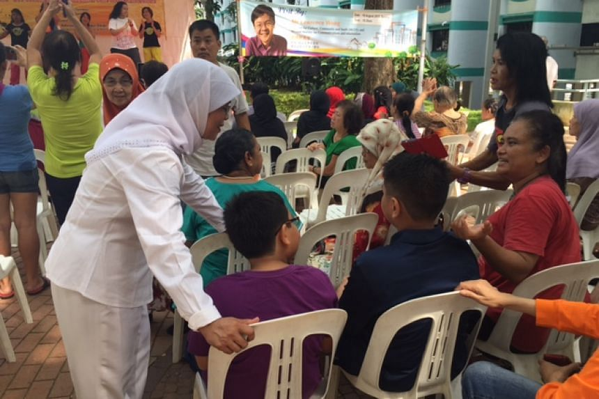 Madam Halimah Yacob, the other anchor MP for the new Marsiling-Yew Tee ward, greeting residents at a community event.
