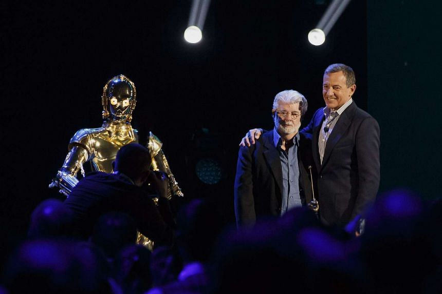 """Star Wars director George Lucas, left, and Robert """"Bob"""" Iger, chief executive officer of The Walt Disney Co., stand for a photograph during the Disney Legends Awards at the D23 Expo 2015 in Anaheim, California, US, on Aug 14, 2015."""