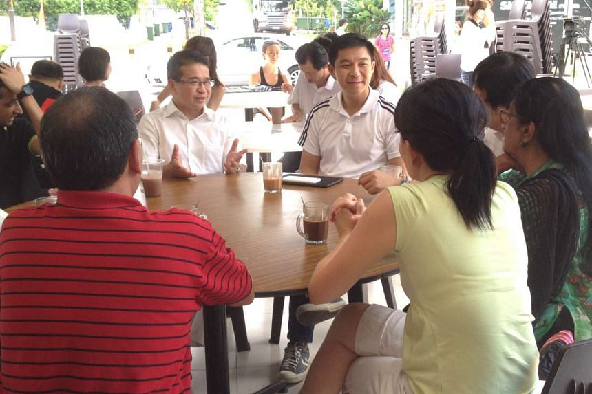 PAP MP Edwin Tong and Minister for Social and Family Development Tan Chuan-Jin, who is also the anchor minister for Marine Parade GRC, chatting with residents at LTN Coffeeshop in Upper East Coast Road on Sunday, Aug 16, 2015.