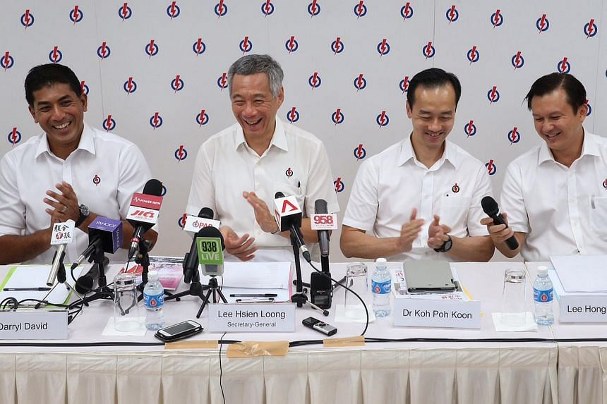 Prime Minister Lee Hsien Loong (second from left) was speaking at the People's Action Party Punggol South branch, where he announced the new six-member slate for Ang Mo Kio GRC and candidates for single-seat wards Sengkang West and Hougang.