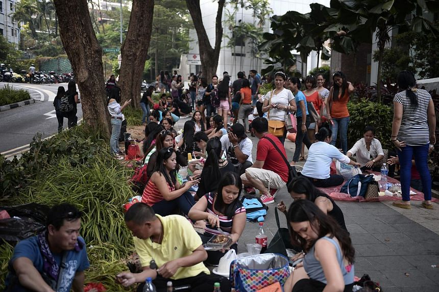 A crowd mostly having picnics in their own groups opposite Lucky Plaza at Tong Building on March 9, 2014.