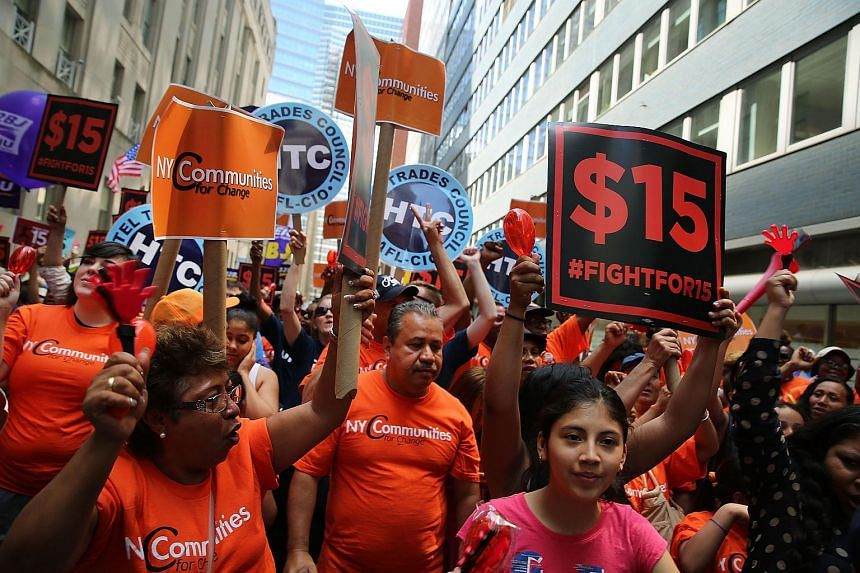 Labour leaders, workers and activists attend a rally for a US$15 minimum hourly wage on July 22, 2015, in New York City.