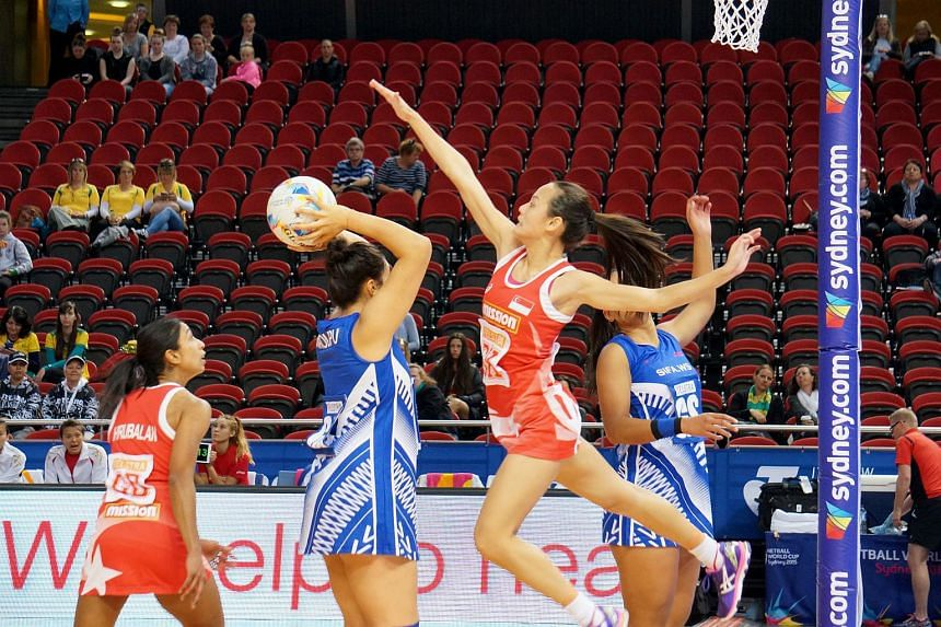 Singapore netballers Micky Lin (second from right) and Premila Hirubalan (left) during the Netball World Cup match between Samoa and Singapore in Sydney on Aug 11, 2015.