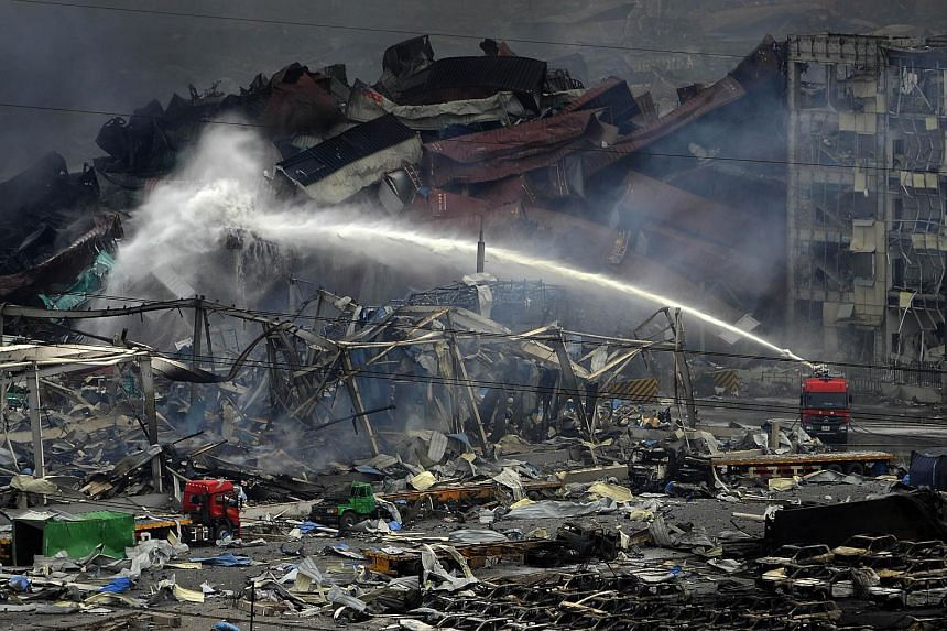 This photo taken on Aug 14, 2015 shows rescuers working at the site of the explosions in Tianjin.