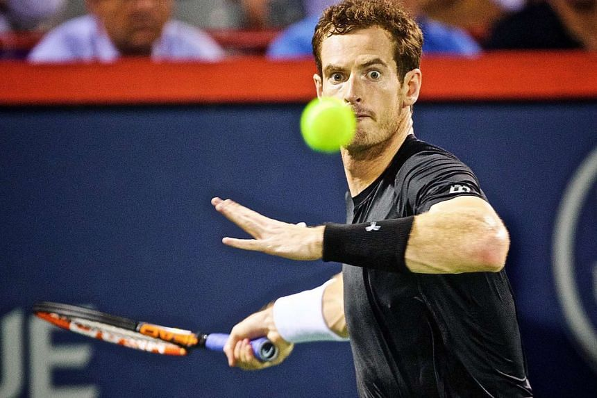 Andy Murray of Great Britain prepares to return a shot against Kei Nishikori of Japan during their men's semi-final singles match at the Rogers Cup Open ATP tennis tournament in Montreal, Canada, on Aug 15, 2015.