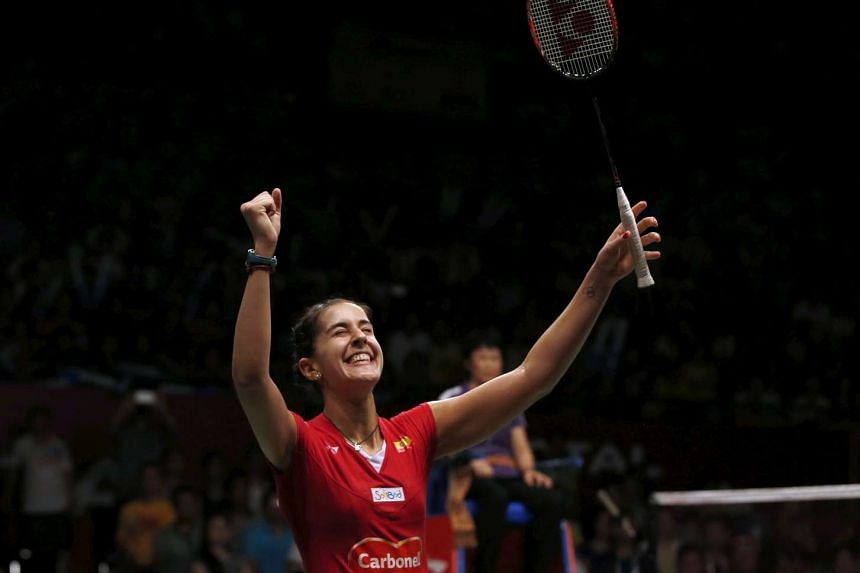 Spain's Carolina Marin reacts winning over India's Saina Nehwal after their women's finals badminton match at the BWF World Championships on Aug 16, 2015.