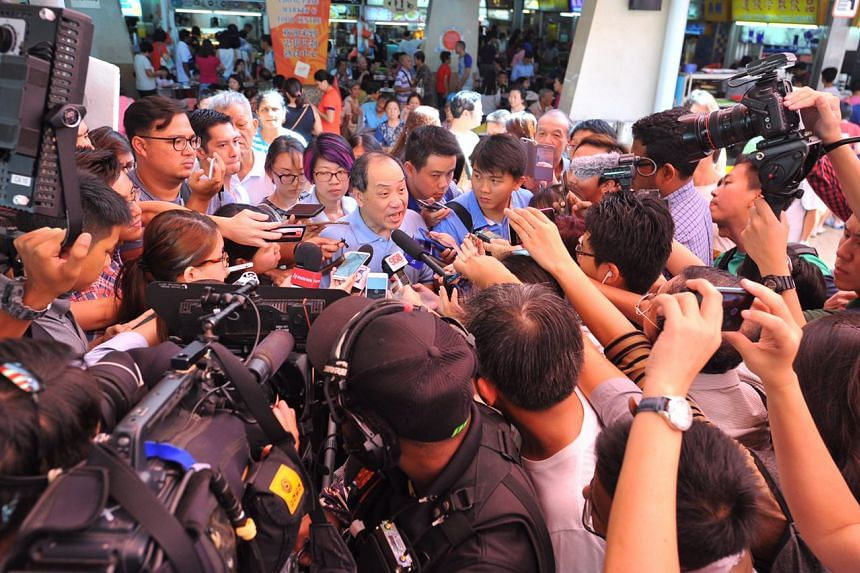 WP's secretary-general Low Thia Kiang speaking to the media at Chong Pang Market and Food Centre on Sunday (Aug 16).
