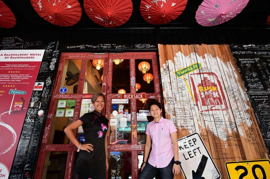 Ms Jacquelyn Chan (left) and Ms Samantha Chan introduced free Wi-Fi and all-day breakfast of toast, condiments, coffee and tea when they opened Rucksack Inn in 2009.