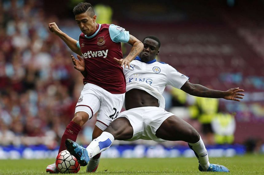 West Ham United's Manuel Lanzani (left) vies for the ball with Leicester City's Jeff Schlupp during the match between the two EPL teams in London on Aug 15, 2015.