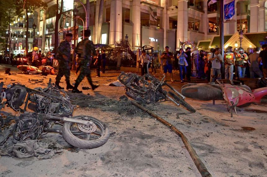 Thai soldiers inspect the scene after a bomb exploded outside a religious shrine in central Bangkok late on Aug 17.