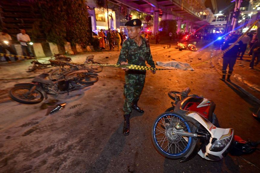 A Thai soldier ropes off the scene after a bomb exploded outside a religious shrine in central Bangkok late on Aug 17.