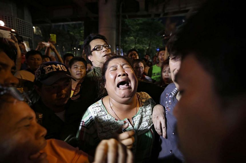 Persons search for missing relatives at the scene of an explosion near Erawan Shrine, central Bangkok, Thailand.