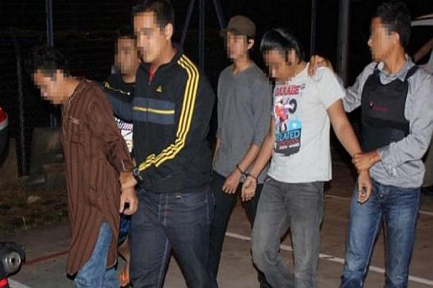 Men arrested in Malaysia for allegedly recruiting for the Islamic State in Iraq and Syria terror group.