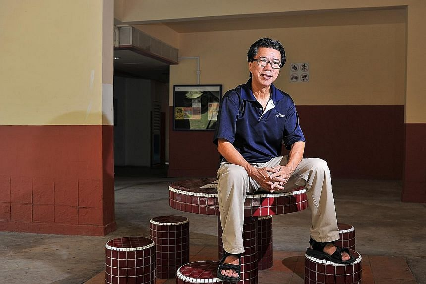 Mr Bernard Chiang, 64, chairman of Braddell Heights Inter-racial and Religious Confidence Circle, at the void deck of Block 5, Lorong Lew Lian, where he had mediated between a Chinese family holding a wake and a Malay family hosting a wedding ceremon