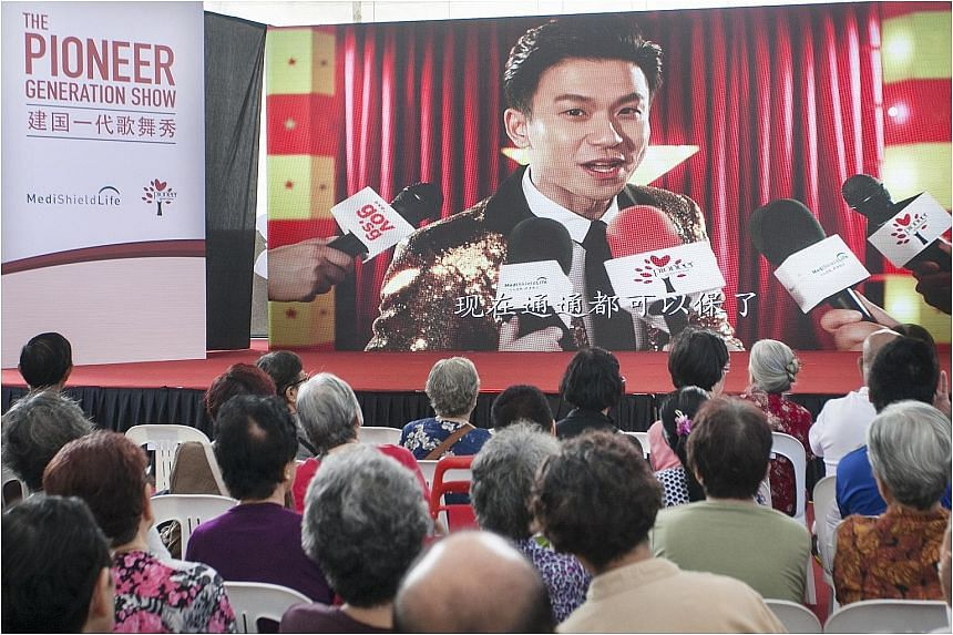 Project Superstar 2 winner Daren Tan sang a popular Sam Hui song with adapted lyrics in his Cantonese video (left) on the Pioneer Generation Package and MediShield Life. He and getai artiste Lee Pei Fen performed on stage after their videos were scre