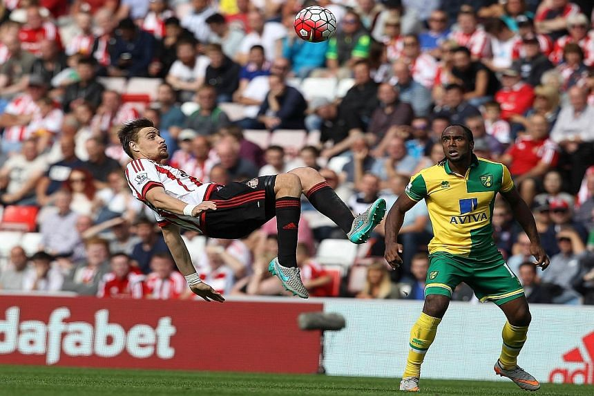 Sunderland defender Sebastian Coates (left) using a bicycle kick to get the ball away from Norwich striker Cameron Jerome. Sunderland fans, though, would hope the Black Cats can avoid the spectacular and get the basics right as the team are rooted to
